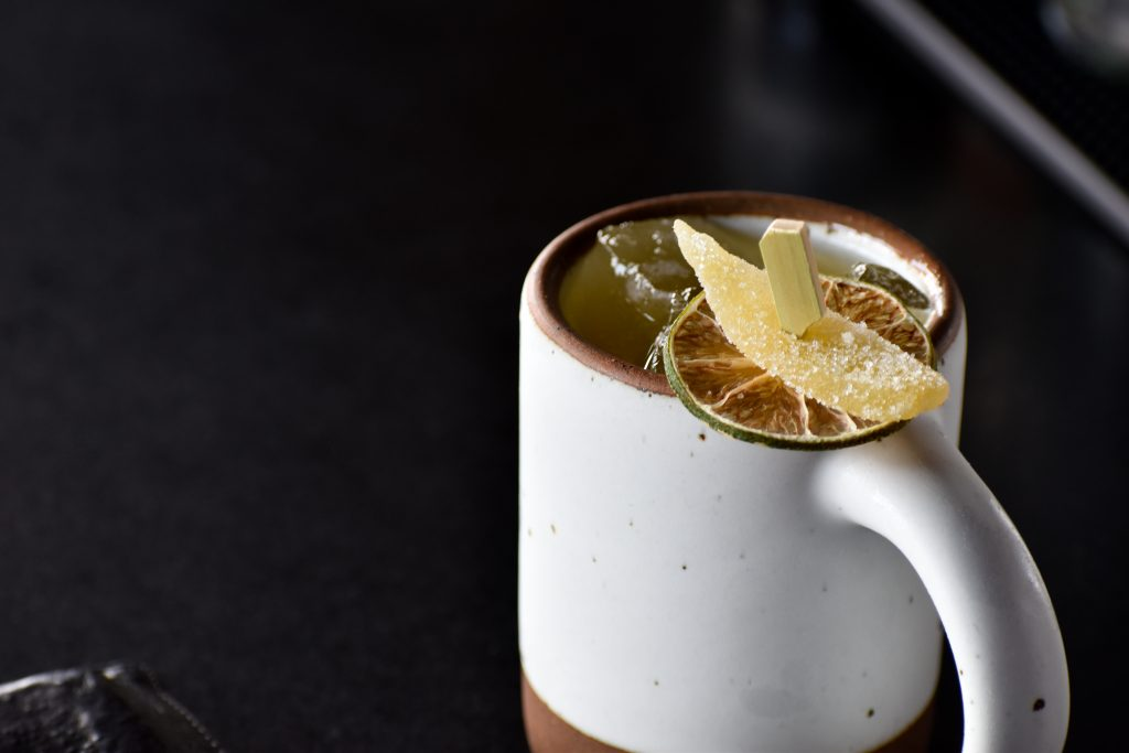 A montford mule at Montford Rooftop Bar garnished with crystallized ginger and dried lime.